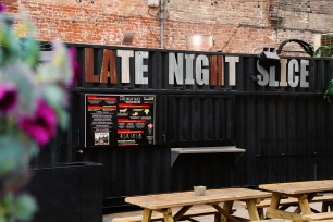 For a casual spot to have a slice or two (or three!), head to Mikey's Late Night Slice. Despite their name, you won't have to wait until the wee hours of the morning to try their delicious Cheezus Crust. The pizza shop operates out of a renovated shipping container, which shares an open-air patio with Oddfellows Liquor Bar.