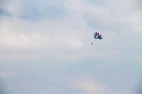 A parasailer soars above Cedar Point Beach on Lake Erie.