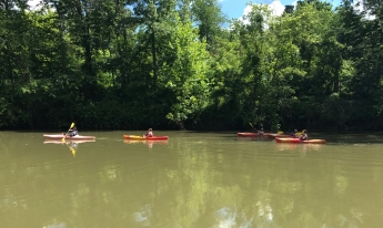 Canoers float peacefully along the Hocking River.