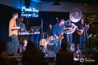 Diners at the west bank of the Flat's Music Box Supper Club enjoy a concert by Huntertones.