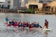 Rowers paddle down the Cuyahoga River in the Flats.